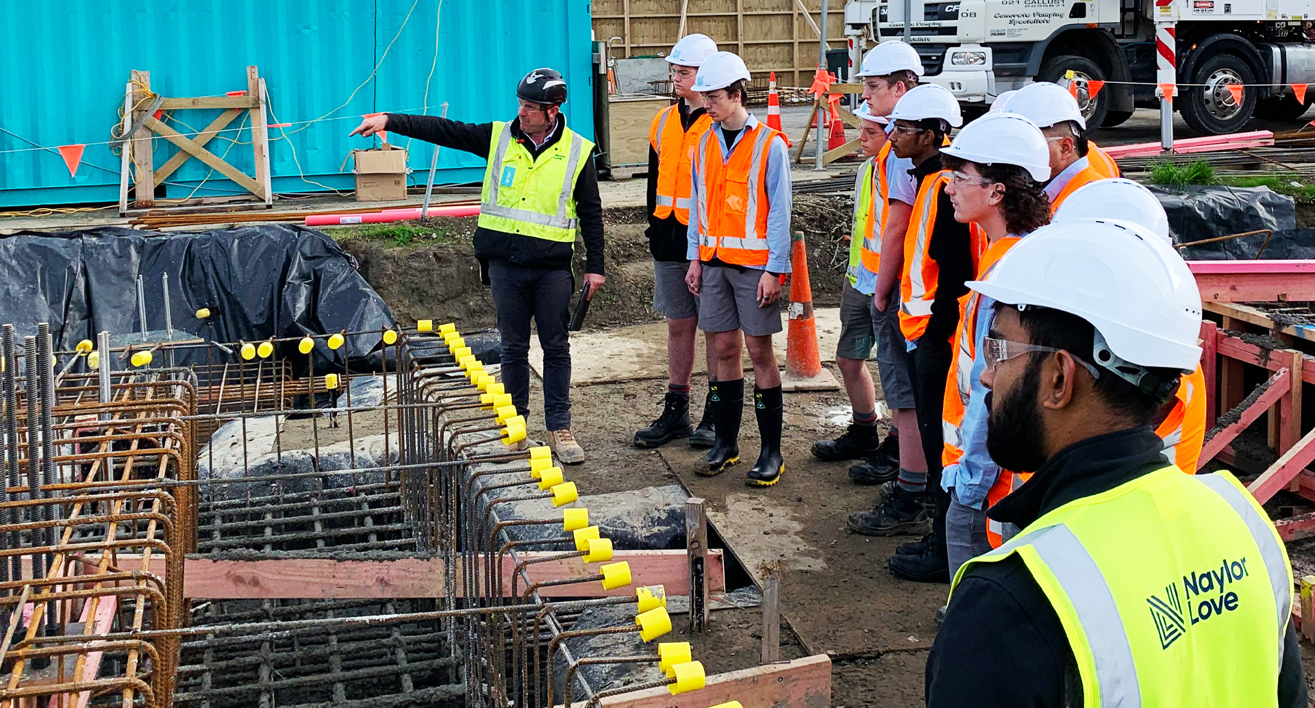 Students in hi-vis and hard hats