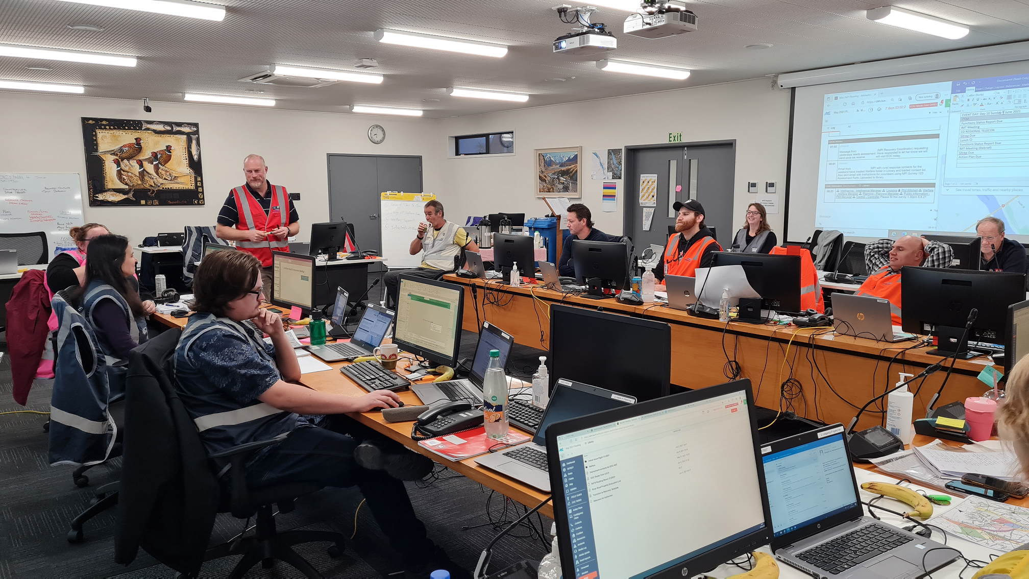 Civil Defence volunteers discussing today's main action points