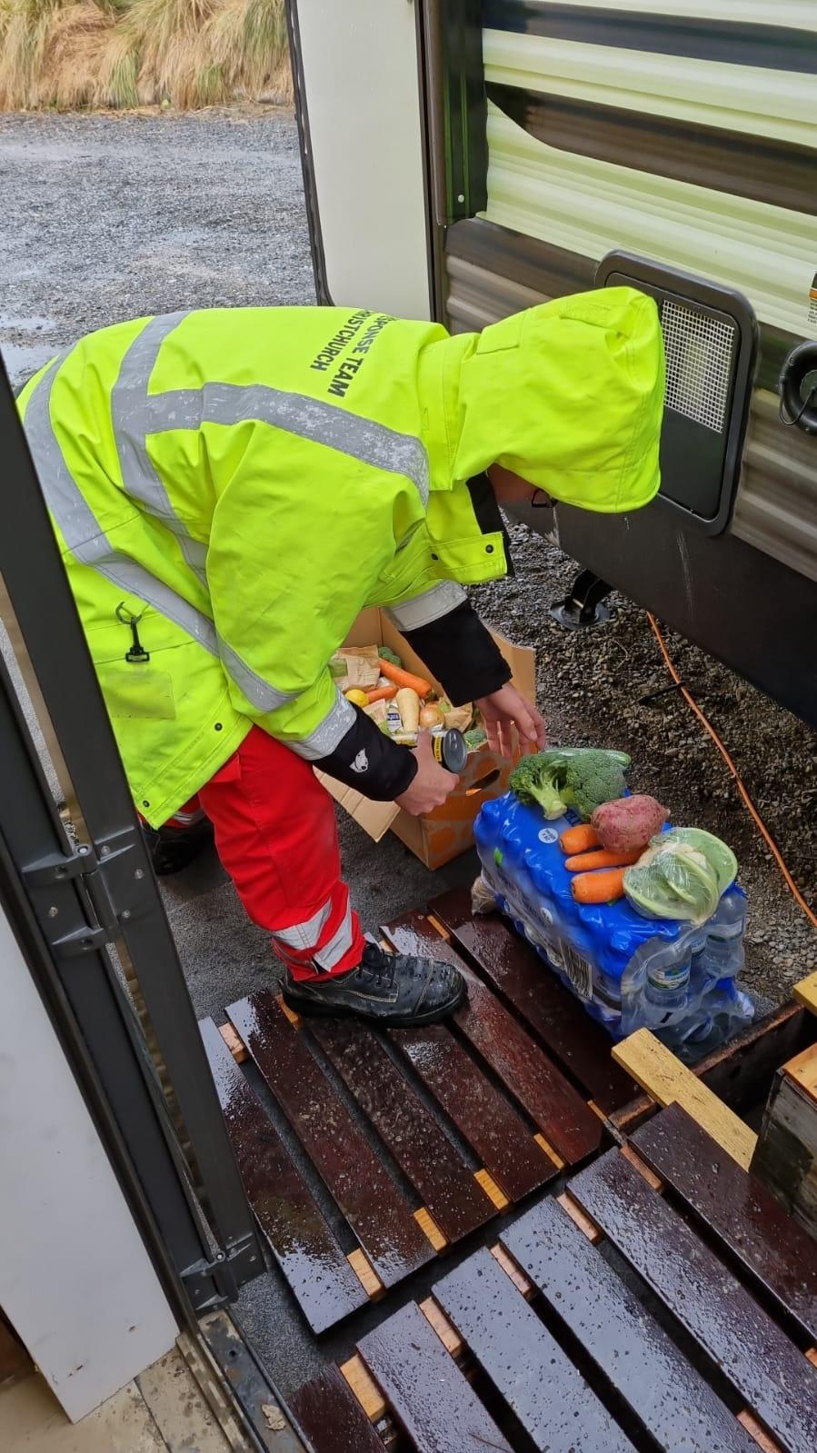 Response Team member delivering food